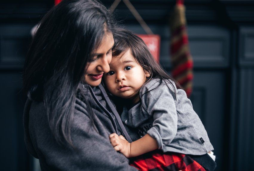 mother-cuddles-her-young-son-850.jpg